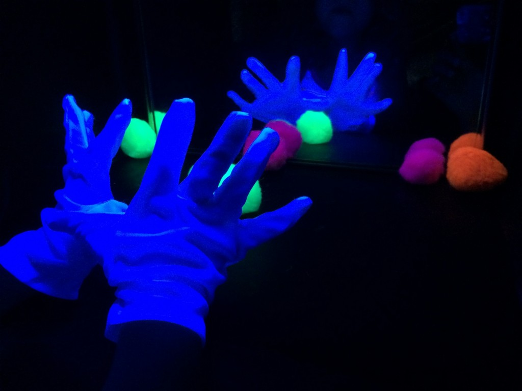 black light booth pom poms