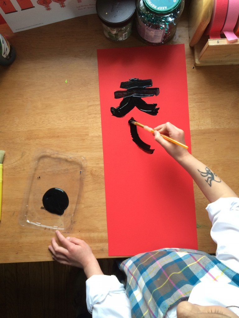 Painting spring couplets for the Lunar New Year