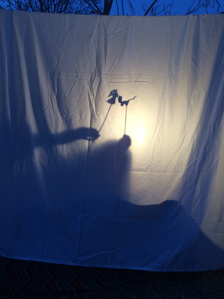Shadow Puppet Play using a bed sheet stage